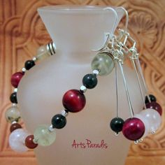 An #Orchard #Visit - #Gemstones in #Fall #Colors This #set was inspired by a trip to go #apple #picking. The light and dark green of the #prehnite and #fancyjasper reminded me of the leaves on the trees. The deep red cat's eye and red of the fancy jasper reminded me of the apples waiting to be plucked. The focal on the bracelet #rosequartz reminded me of the inside of a rome apple. #handmade jewelry #ArtsParadis