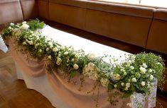 セレモニーアーチをイメージしてしだれる感じにしてみたいです。 白い小花がかわいい。エアリーな感じに仕上げたいです。これよりも深い緑にしたい