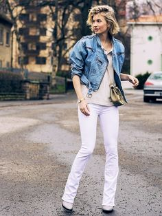 Zanita Whittington of Zanita wearing a denim jacket, simple top, and white flared jeans