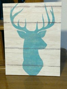 Super easy wall decor. Looks like a buck deer head painted on birch but it's really a piece of scrapbook paper that I mod podged onto a flat piece of wood sample. Wall decor for less than a buck!