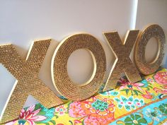 Large XOXO sequin letters for wedding or decor, Featured in BRIDES magazine. $115.00 USD, via Etsy.