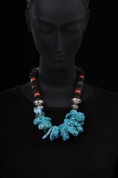Turquoise, antique African coral, silver, and coconut beads.