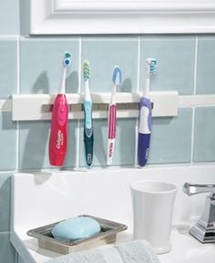 Magnetic toothbrush holder... This is a brilliant idea because I hate it when someone else's toothbrush is touching mine - weird I know