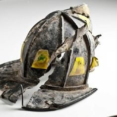Fire helmet that was broken into pieces from Fire Department Squad 18 discovered in the debris after the terrorist attacks.