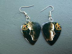 Hunger Games Katniss and Peeta Guitar Pick Earrings Hook. $6.50, via Etsy.