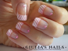 Cute french manicure with diagonal stripes in pink and white ♡ (would prefer it without the rhinestones though)