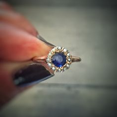 We are in love with this delicate little antique daisy flower ring. You see, she's just back from a visit to the jewelry doctor, who fixed her up as good as new. We saw that Butter Lane Antiques posted her first cousin (sapphire and diamonds instead of blue garnet and pearls) and just had to share. Now she's been posted in our shop! She was once an engagement ring, and more recently the something old, borrowed and blue for a new bride. Could she be yours? * vintage…