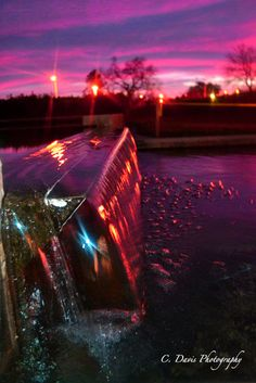 sunset over the water fountain