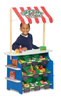 Whatever the season or weather, this wooden play center has the shop for you! This kids lemonade stand--OR grocery store--features portable plastic bins for pretend shopping or storage, removable chalkboard signs, a spacious countertop, and a reversible fabric awning.