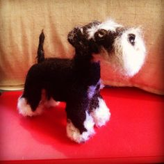 This is a #needle felted #schnauzer of Mr Ivan x TeaFeltdesign in Etsy