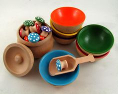 Sorting bowls and mushroooms is a classic waldorf educational style toy.  The sorting bowls are 1 1/8 inches high by 2 1/2 inches wide which are a perfect size for little fingers to grasp. All of our toys are hand painted with non-toxic acrylic paint and sealed with a couple coats of gloss. This keeps the toys vibrant and completely sealed without having to worry about dye from the colour transferring all over your child if they happen to get the toys wet.  Explore and Learn Wooden ...
