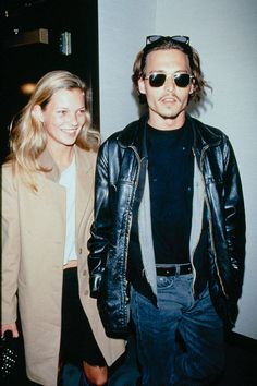In 1995, the pair plays with layers—including, in Depp's case, sunglasses.   - ELLE.com