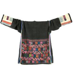 heres a unique vintage jacket made by the Akha tribal people. the Akha are one of many indigenous minorities living in Laos, Vietnam, Thailand, Myanmar and China, usually in the mountainous areas - this jacket was found in Northern Vietnam. it is made from indigo-dyed, almost black, handspun and hand-woven hemp and adorned with intricate, tiny Akha cross-stitch embroidery in geometrical shapes on its lower back. jackets like this are worn as part of the ceremonial Akha costume, together with…