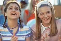 Cher Horowitz wearing a pink jumper and hairband, Clueless