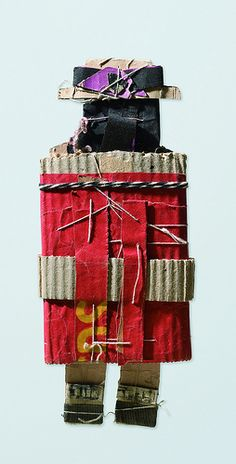 James Castle (1899-1977), Woman in red coat and boater hat, Construction of thin gray cardboard faced with pink coated paper, gray corrugated cardboard, animal feed bag, white, black, and blue papers with string, braided yarn, soot and spit, blue and red wax crayon; 11 1/2 x 4 1/2 inches. Collection of Susan and Alvin Chereskin, New York.