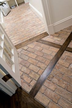 Brick and hardwood Flooring The new entry was outfitted with brick floor set in a diamond pattern and intersected by wooden planks matching the pine of the kitchen floor. The brick runs into the mudroom for a durable and unique surface Brick Flooring, Kitchen Flooring, Hardwood Floors, Brick Floor Kitchen, Entryway Flooring, Classic Home Decor, Classic House, Classic White Kitchen, Leaded Glass Windows