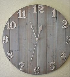 DIY rustic clock. Looks like you could make this with pieces of pallet wood, or simply go to the Home Depot and have them cut the pieces for you. Add metal numbers, and youve got yourself a fabulous wall clock!!