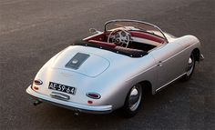 Porsche 356 with top down and interior showing. #RedLeather