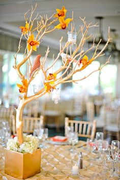 For a sweet spring centerpiece, dress up your branches with a few flowers and faux birds.