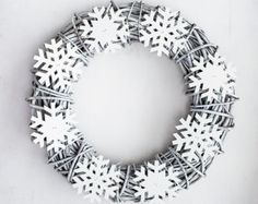 Add a warm touch to your Holiday decorations, indoors or out. This wreath is made on a wicker base, adorned with Christmas balls, high quality artificial greenery, wooden snowflakes, dried petals, and burlap ribbon. Dimensions: diameter: 11, total length: 16 *Due to the handmade nature of this wreath it may vary slightly from the image - this is all part of its unique charm. :: More Christmas Holiday Wreaths and decorations: http://www.etsy.com/shop/botanicbotanic?section_id=12329451