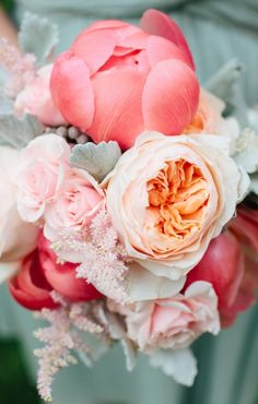 Peach garden roses and coral peonies, light pink spray rose and dusty miller. I like the color palette