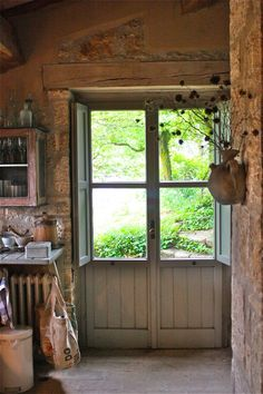 Italian kitchen door In country home in Umbria. This was be a great installation on a wall over a window..faux door. Shutters and beadboard. Love it!