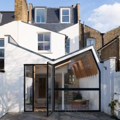 "Forrester+Architects'+London+house+extension+has+a+""butterfly""+roof+and+exposed+wooden+rafters"