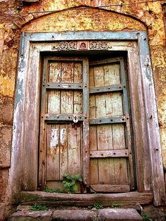 Beauty is in the eye of the beholder, and I love old doors in worn walls.
