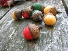Glue pompoms onto acorn caps for easy and cute fall craft.