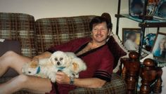 """Gary Leon Ridgway, """"The Green River Killer"""" seen here in the late 1980s snuggling up to a couple puppies. He confessed to murdering 71 women."""