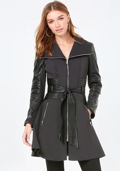 Incredibly cool coat with edgy exposed zips and faux leather moto detailing. Detachable tie belt. Front zip pockets. Exposed front zip closure. Fully lined.