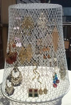 Everyone who has seen this keeps telling me to pin it, so I am! I turned a mesh garbage can from the dollar store upside down and hung my earrings on it.