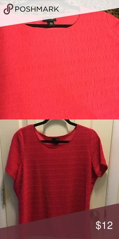 "Cut short sleeve top. Dress this top up or down! Pit to pit 22"". Length 27"". Poly/ spandex. Color is between pink & coral. East 5th Tops"