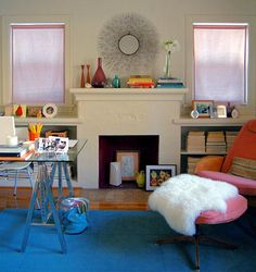 dislike backwards books, poor curtains, and the exact things he used, but love the blue rug, pink chair, bright accents and PINK fireplace inside