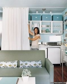 The curtain separator works for a kitchen too. | 22 Brilliant Ideas For Your Tiny Apartment