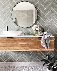Bathroom decor for the master bathroom renovation. Learn bathroom organization, bathroom decor a few ideas, master bathroom tile ideas, bathroom paint colors, and much more. Bathroom Goals, Laundry In Bathroom, Bathroom Renos, Bathroom Renovations, Small Bathroom, Master Bathrooms, Bathroom Feature Wall Tile, Round Bathroom Mirror, Green Bathroom Tiles