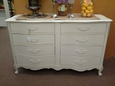 sold - This French Provincial style chest has 8 drawers - it has been painted a creamy white and lightly distressed ***** In Booth H13 at Main Street Antique Mall 7260 E Main St (east of Power RD on MAIN STREET) Mesa Az 85207 **** Open 7 days a week 10:00AM-5:30PM **** Call for more information 480 924 1122 **** We Accept cash, debit, VISA, Mastercard, Discover or American Express