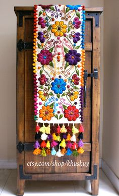 Back in stock!  Sheep wool runner hand embroidered with graceful flowers and leafs, finished with multicolored tassels. Gorgeous at your dinner table or
