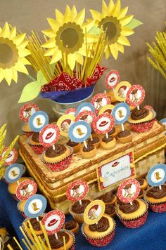 Toy Story Party for a Woody & Jessie tablescape. The paper sunflowers & wicker picnic basket as a riser are nice touches.