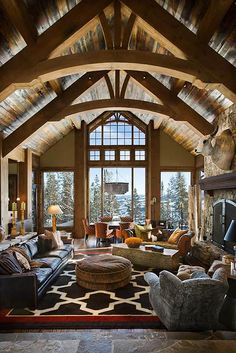 Great Room with huge windows, clerestory windows, massive timbers. Bear Trap by Locati Architects and Teton Heritage Builders