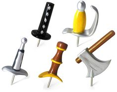 Medieval Weapons Pushpins  http://www.geekalerts.com/medieval-weapons-pushpins-set/
