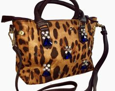 Leopard print tote bag with opulent blue crystals embellishment fashionable stylish smart and classy unique and stunning for all occasions