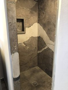 Concrete shower with stamped pan, matching soap box and concrete curb. One of a kind! Shower Floor, Shower Panels, Faux Marble Paint, Wall Panels, Concrete, Concrete Shower, Wall Paneling, Concrete Stained Floors, Shower Wall