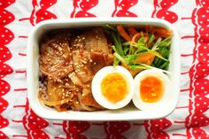 Sauteed pork donburi style bento with boiled egg and veg made in under 15 minutes