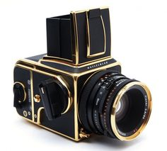 hasselblad. camera.  My friend used this one to shot weddings I sure would have loved to own this gold plated camera, the astronauts used the Hasselblad on the moon and in space to get the wonderful photos.