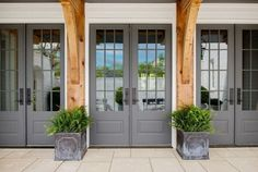 "The gray French doors are painted in ""Benjamin Moore's Chelsea Gray"" Family Home with Inspiring Neutral Interiors Awesome front door color Front Door Paint Colors, Painted Front Doors, Exterior Paint Colors, Exterior House Colors, Exterior Design, Gray Front Doors, Door Design, Grey Doors, Paint Colours"