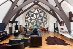 church converted into a house... I would re-decorate but I love the beams and unique window!!!!