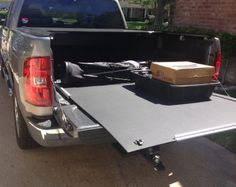 U-shaped aluminum channel screwed to plywood. plywood deck slides in channel Cargo Slide Truck Bed Slide Tool Shop Organization, Decked Truck Bed, Truck Bed Slide, Deck Slide, Truck Bedroom, Truck Bed Storage, Pink Truck, Truck Bed Accessories, Travel Trailer Remodel