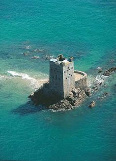 Seymour Tower, Jersey, Channel Islands, UK.  Two miles offshore - cut off at high tide, accessible on foot at low tide (best done with an experienced guide).  Tower available for overnight rental: http://www.jerseyheritage.org/heritage-holiday-lets/seymour-tower    travel, holidays