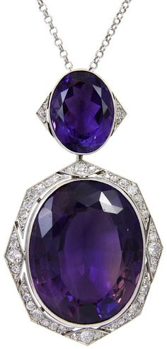 This is an absolutely stunning Art Deco amethyst and diamond pendant. The two…